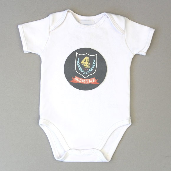 "Our free month onesie stickers are a fun and unique way to capture your baby's monthly milestones in style! Available in a design for baby boys and girls, these free printable stickers are easy to download, print out on sticker paper, cut and stick. The stickers measure 4"" in diameter for a perfect fit to apply on your baby's shirt, bodysuit or onesie.  Grab your camera, take some cute photos and document each of babies first 12 months. This set includes 12 monthly baby stickers and make a great baby shower gift for the mother-to-be.* Disclaimer: Please remove Baby Month Onesie Stickers before washing. Do not leave child unattended with sticker. Not intended as a toy."