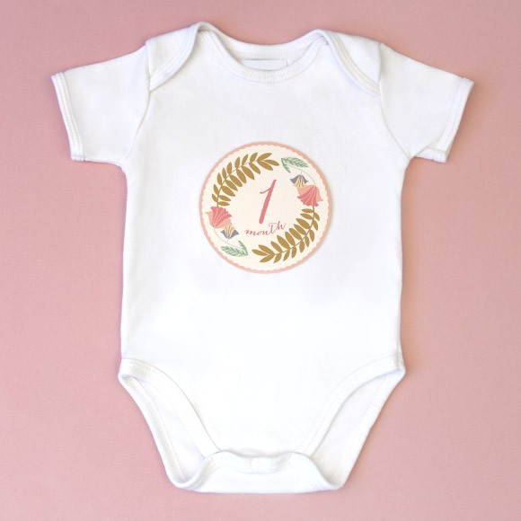 "Our free monthly onesie stickers are a fun and unique way to capture your baby's monthly milestones in style! Available in a design for baby boys and girls, these free printable stickers are easy to download, print out on sticker paper, cut and stick. The stickers measure 4"" in diameter for a perfect fit to apply on your baby's shirt, bodysuit or onesie.  Grab your camera, take some cute photos and document each of babies first 12 months. This set includes 12 monthly baby stickers and make a great baby shower gift for the mother-to-be.* Disclaimer: Please remove Baby Month Onesie Stickers before washing. Do not leave child unattended with sticker. Not intended as a toy."