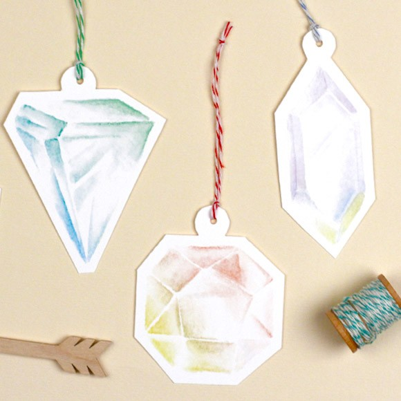 These gift tag printables in the shapes of colorful Gemstones will adorn any of your holiday packages and gifts. This printable template comes with 5 unique gift tag designs in a variety of pretty colors. There is plenty of room for a personal message on the back of the gift tag. All you have to do is download the PDF and print the file via Adobe Acrobat. Cut out the different shapes, punch a hole in the top and attach a fun piece of twine. Have fun!!